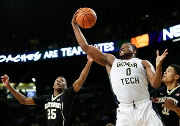 Georgia Tech's Charles Mitchell, right, grabs a rebound from Wake Forest's Cornelius Hudson, left, in the second half of an NCAA college basketball game, Saturday, Feb. 7, 2015, in Atlanta. Georgia Tech won 73-59. (AP Photo/David Goldman)